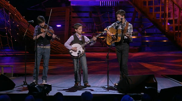 Three brothers playing bluegrass music